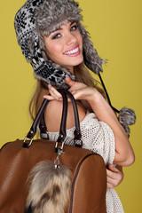 Vivacious Young Woman Carrying Bag