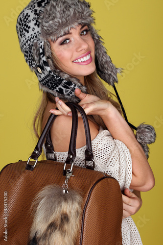 Vivacious Young Woman Carrying Bag