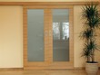 Sliding wooden door with dracena plant