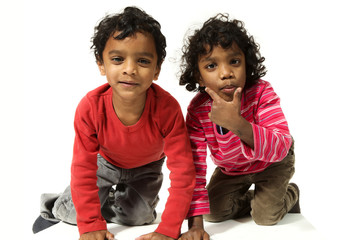 two indian kids together, male and femal