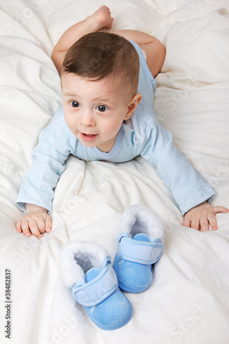 Image of little baby with shoes