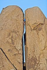Rock climber in a crack.