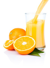 Fresh Oranges Juice Pouring into a Glass Isolated on white backg