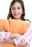 Hispanic girl wearing pajamas isolated on white
