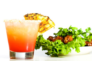 Tropical fruit drink and chicken wings