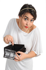 Young woman opening empty coin purse