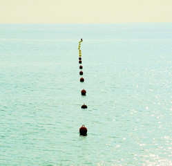 mediterranean landscape with a buoy on a beach of barcelona, spa