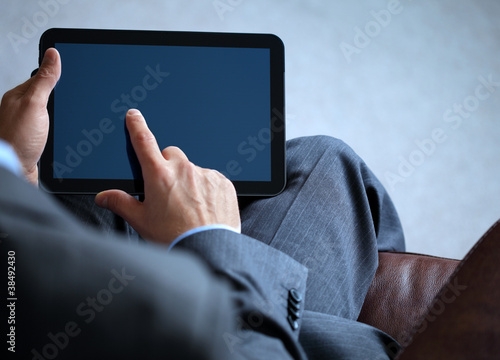 Business man working on digital tablet