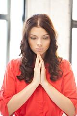 praying businesswoman