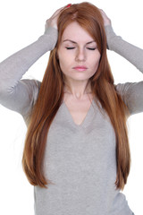 Unhappy young woman with bad headache on white background