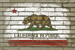 grunge flag of US state of california on brick wall painted with