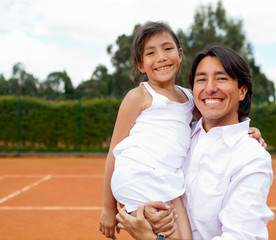 Family at a tennis court