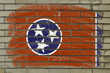 grunge flag of US state of tennessee on brick wall painted with