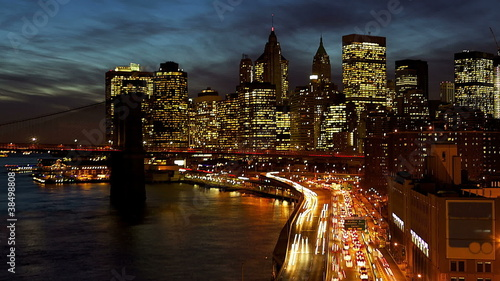 New York City Manhattan with Brooklyn Bridge at dusk time lapse