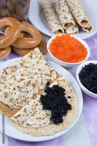 Pancakes with red and black caviar
