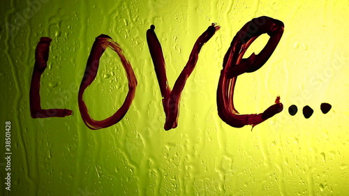"The inscription ""love"" watches off on a yellow background"
