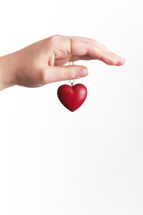 Hand protecting a heart