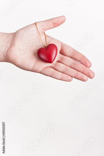 Hand showing a red heart