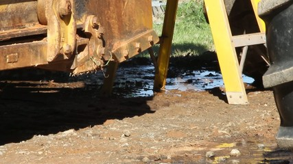 Ladder And Machine Ground Area Water Runoff