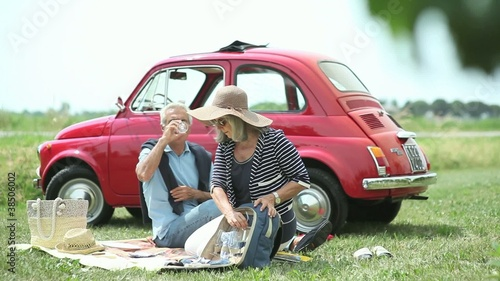 Happy senior couple enjoying their pic-nic; Full HD Photo JPEG