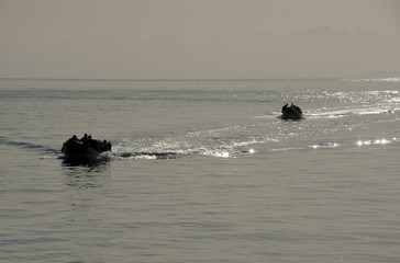 Inflatable boats carrying scuba divers