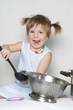 studio shot of young happy girl cooking
