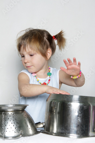 studio shot of cooking child