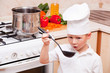 little boy on kitchen helps to make a dinner