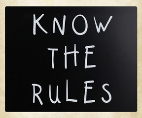 Know the rules - handwritten with white chalk on a blackboard