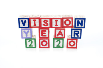 Alphabet blocks spelling Vision Year 2020