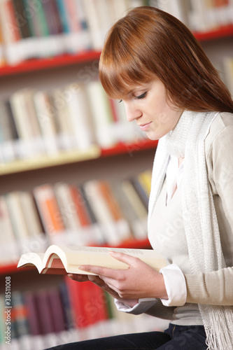 Young student reading in a library