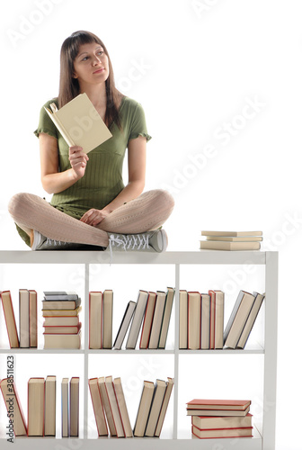 Thinking woman holding a book, cover is blank