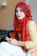 Young muslim stylish women writing text messaging