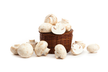 champignones in wooden basket isolated on white
