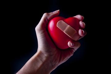 Hand Holding a Broken Heart