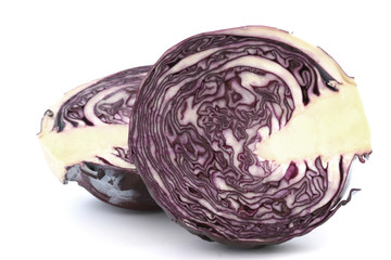 Inside raw red cabbage halves close up on white background