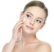 Beauty woman applying cream on face