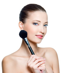 woman  with make-up brushe for applying  rouge