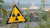 Radioactivity sign and the city.
