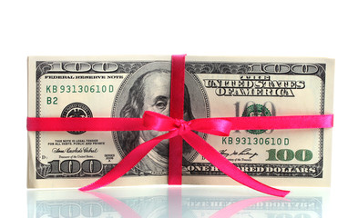 A lot of one hundred dollar bills tied pink ribbon isolated