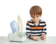 The boy looks at the thermometer. Isolate on white background