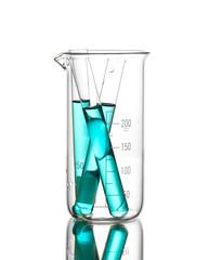 Laboratory tubes with blue liquid in measuring beaker