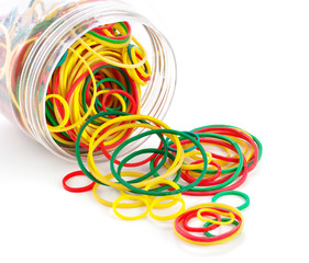 Elastic bands in bank on a white background