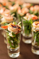 Tasty appetizer of shrimps and arugula
