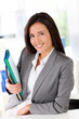 Cheerful saleswoman holding files