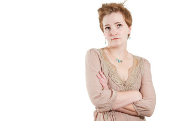 Annoyed woman isolated over white