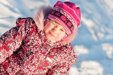 Baby sits on snow portrait