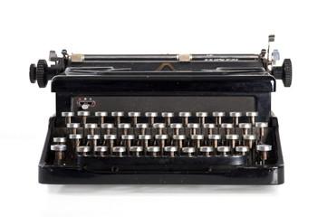 Vintage black typewriter isolated on white background.