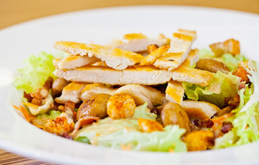 Chicken salad with grated carrots, mushrooms, bread croutons and