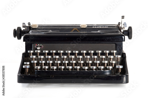 Vintage black typewriter isolated on white background.